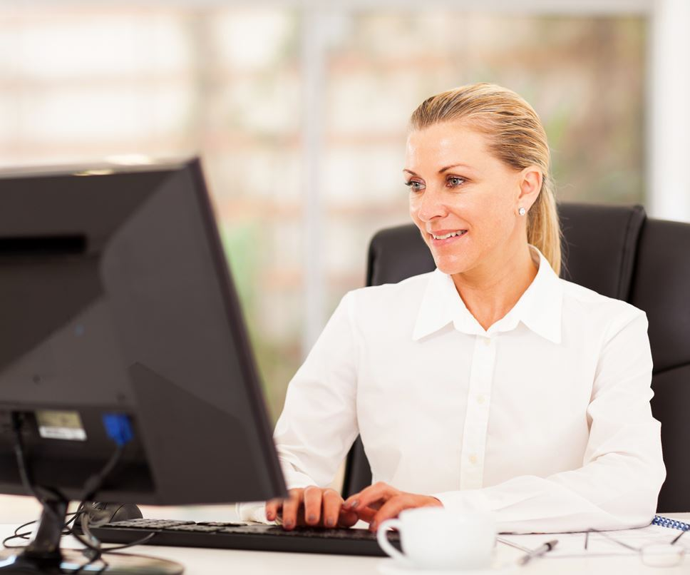 Image of a woman watching a webinar on a computer
